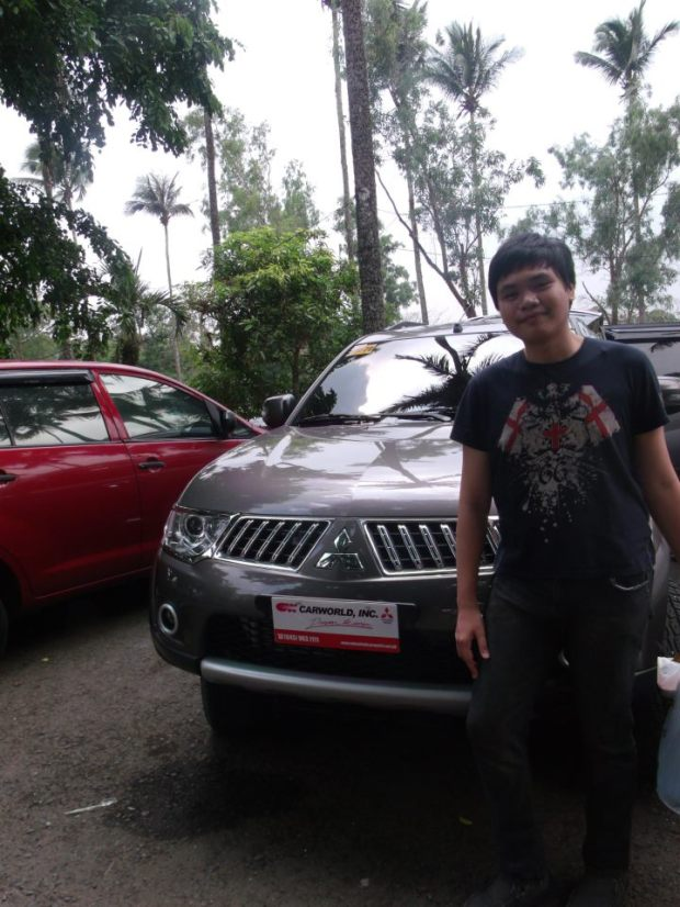 With Mom's new car. She worked hard for it and got it. Totally deserves it.